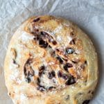 No Knead Cranberry Nut Bread on a piece of parchment paper