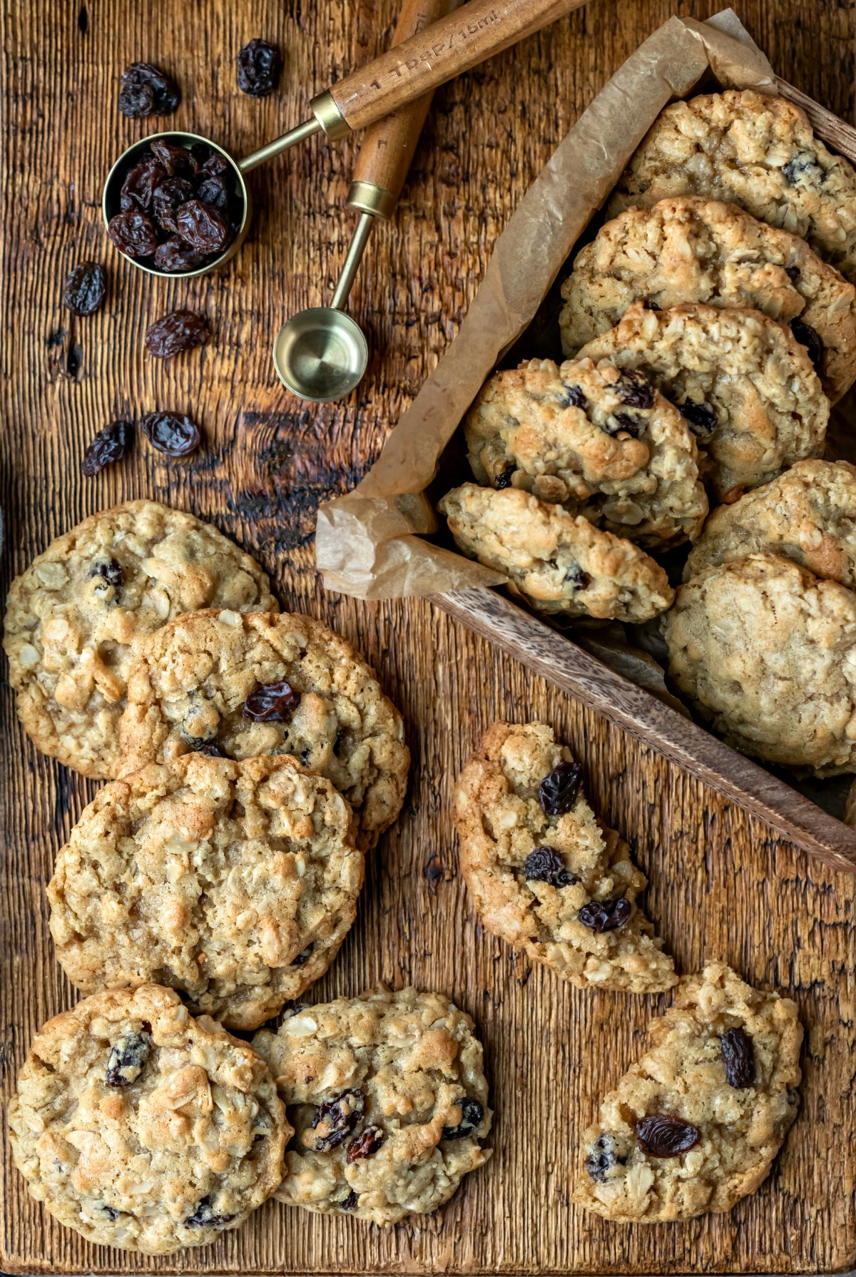 Overhead photo of oatmeal raisin cookies on a wooden cutting board
