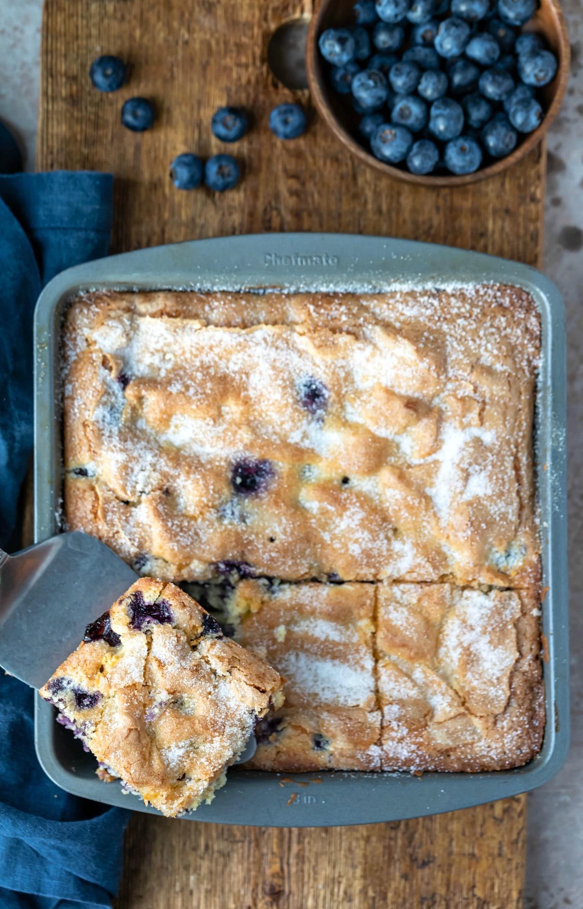 Slice of blueberry cake on a silver spatula