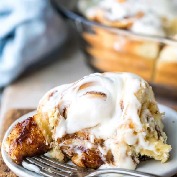 Homemade cinnamon roll on a white plate