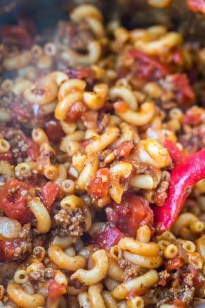 Pink spoon scooping up Instant Pot goulash