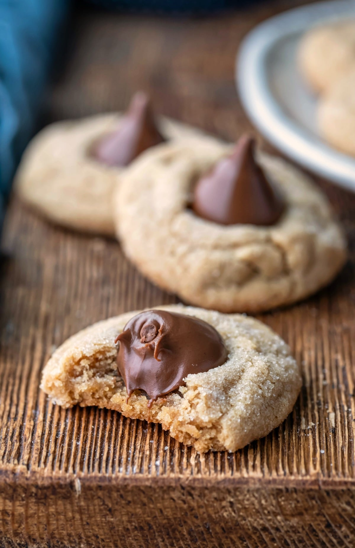 Peanut butter kiss cookie with a bite missing