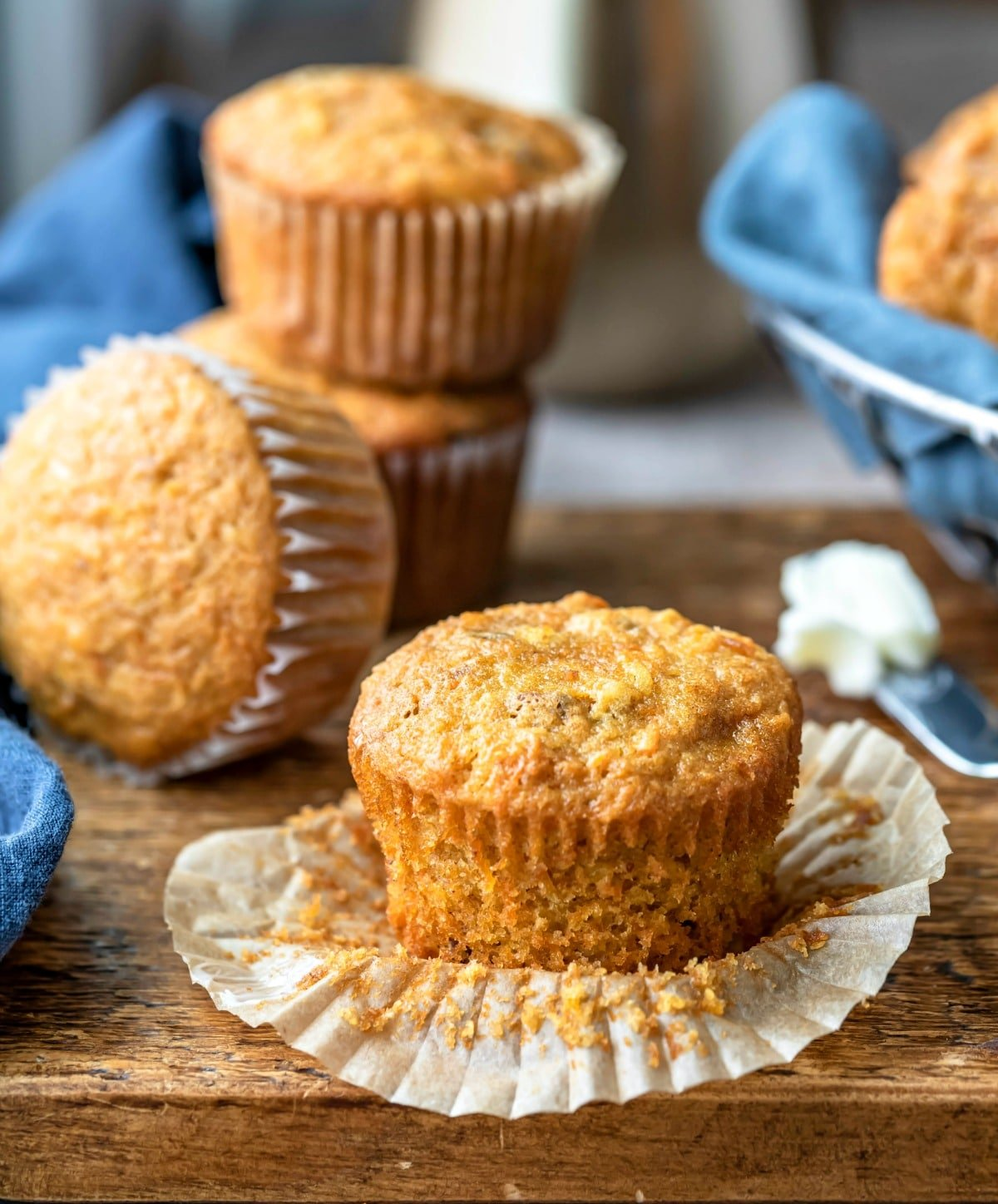 Carrot cake muffin next to three carrot cake muffins