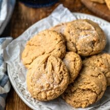 Plate of chewy peanut butter cookies on a wooden cutting board