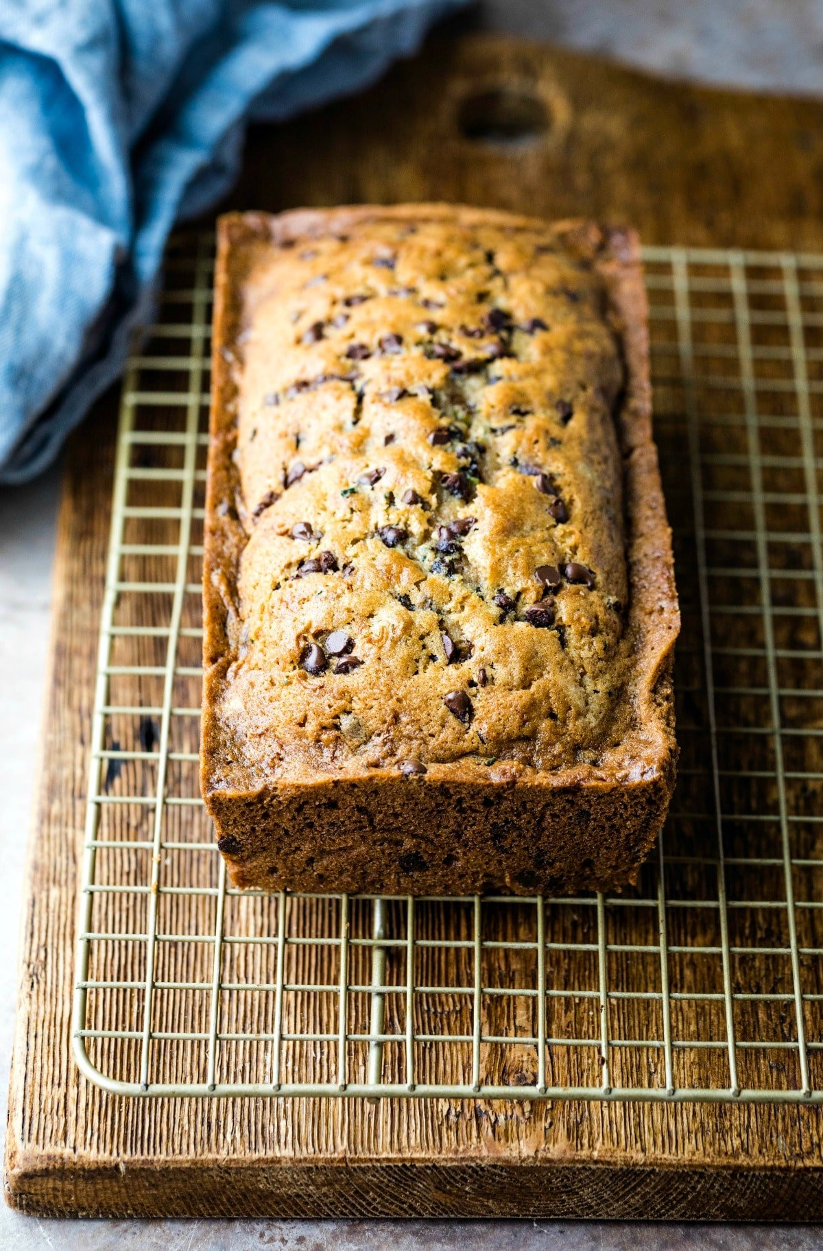 Loaf of chocolate chip zucchini bread on a wire cooling rack