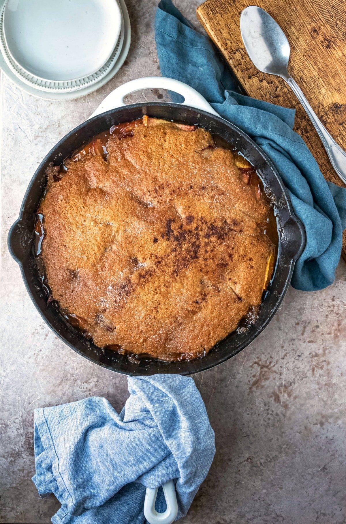 Brown sugar peach cobbler in a white skillet
