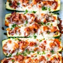 Zucchini boats filled with sausage sauce and cheese
