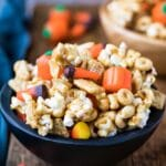 Halloween snack mix in a black wooden bowl