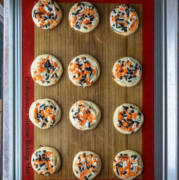Halloween sprinkle cookies on a silicone baking mat