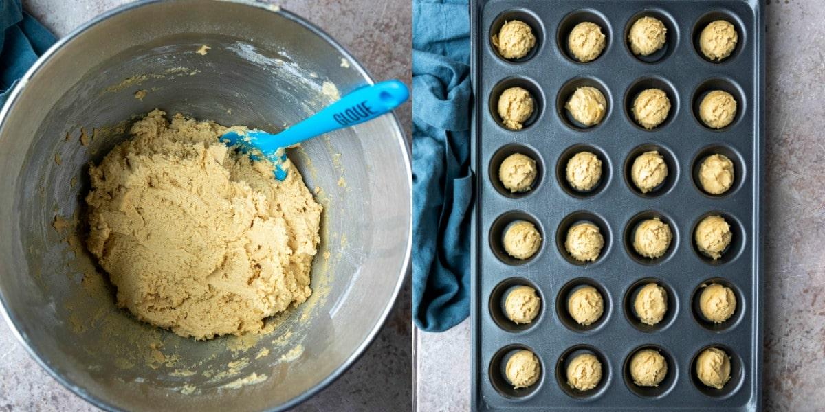 Peanut butter cup cookie dough in a mini muffin tin.