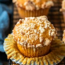 Pumpkin Streusel Muffins on a black wire cooling rack