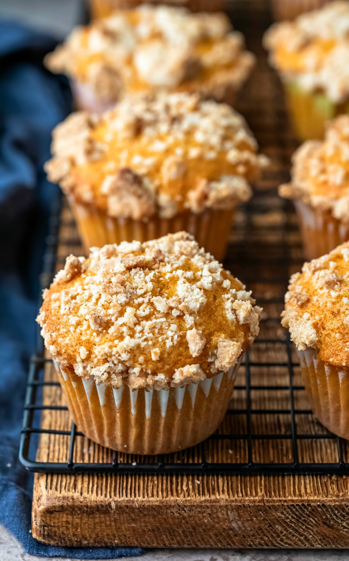 Row of pumpkin streusel muffins on a wooden cutting board