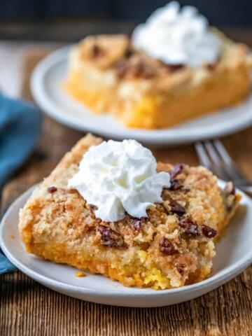 Two slices of pumpkin pie cake on white plates