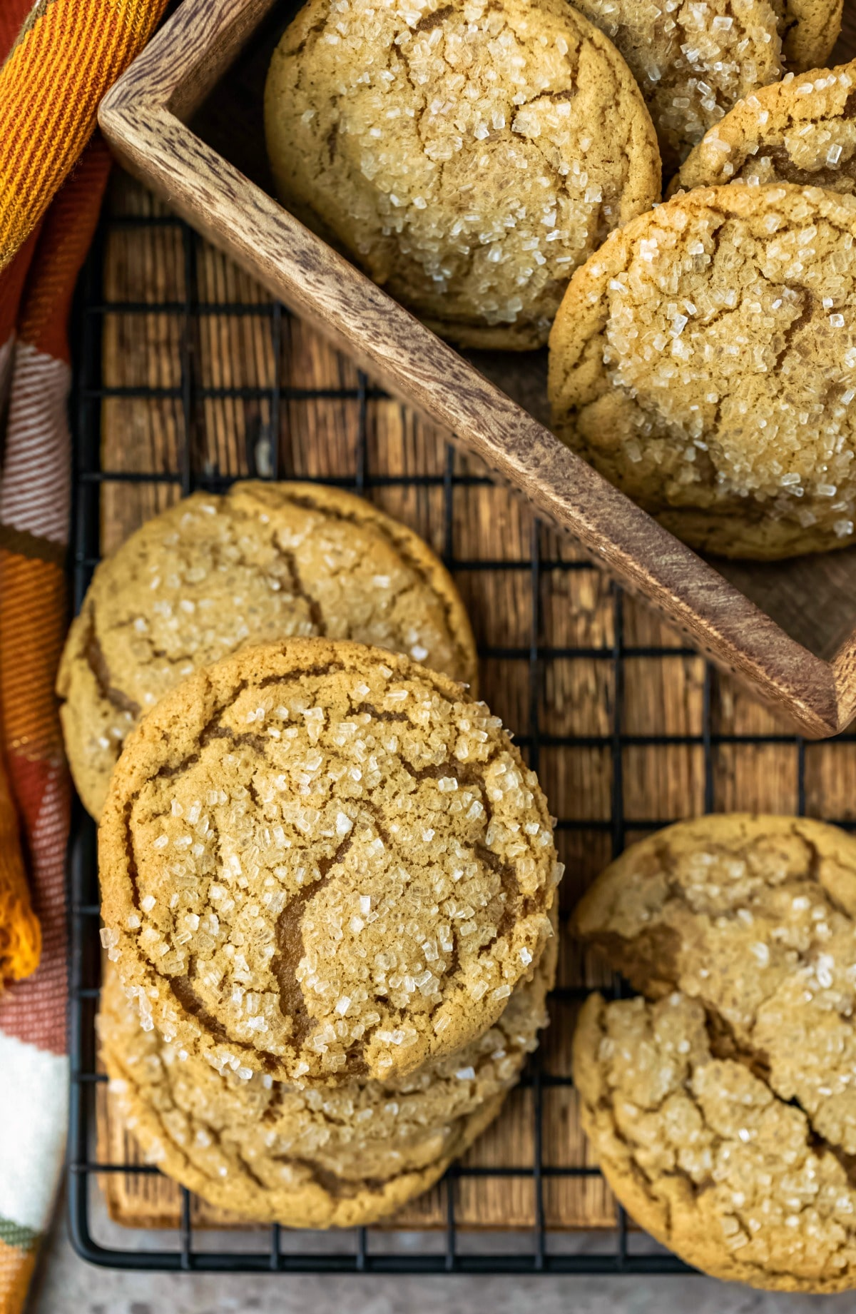 stack of ginger molasses cookies on a black metal baking rack