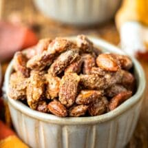 Two pottery ramekins filled with roasted glazed cinnamon almonds