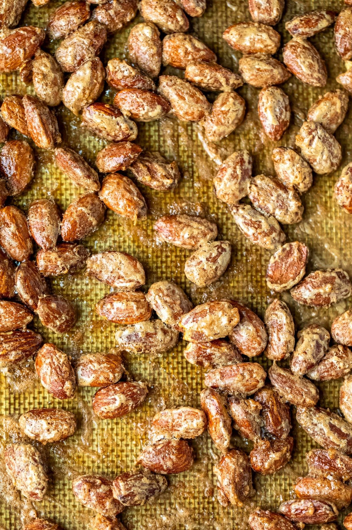 Baked cinnamon almonds on a silicone baking mat
