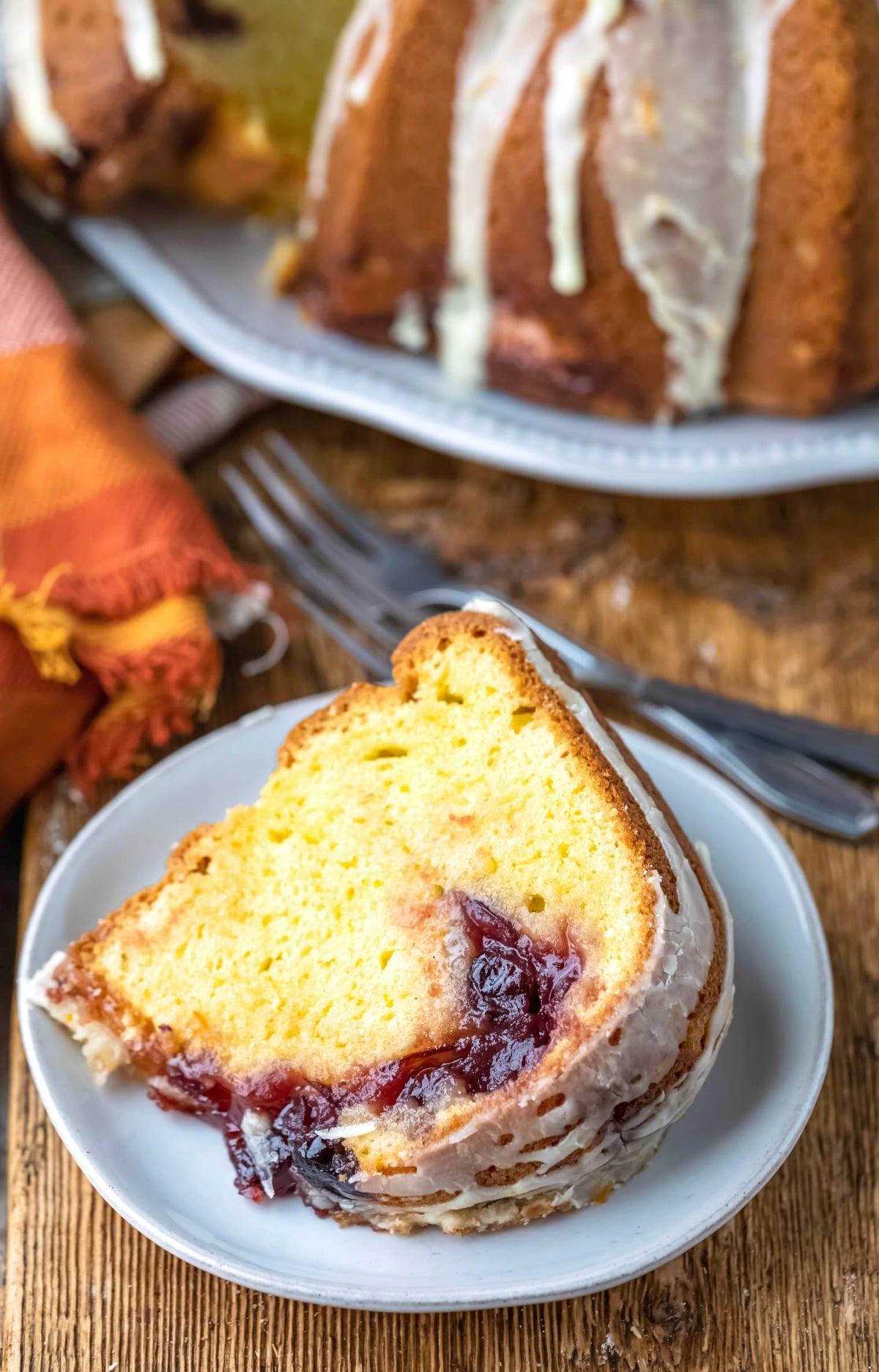 Slice of cranberry orange pound cake on a white plate