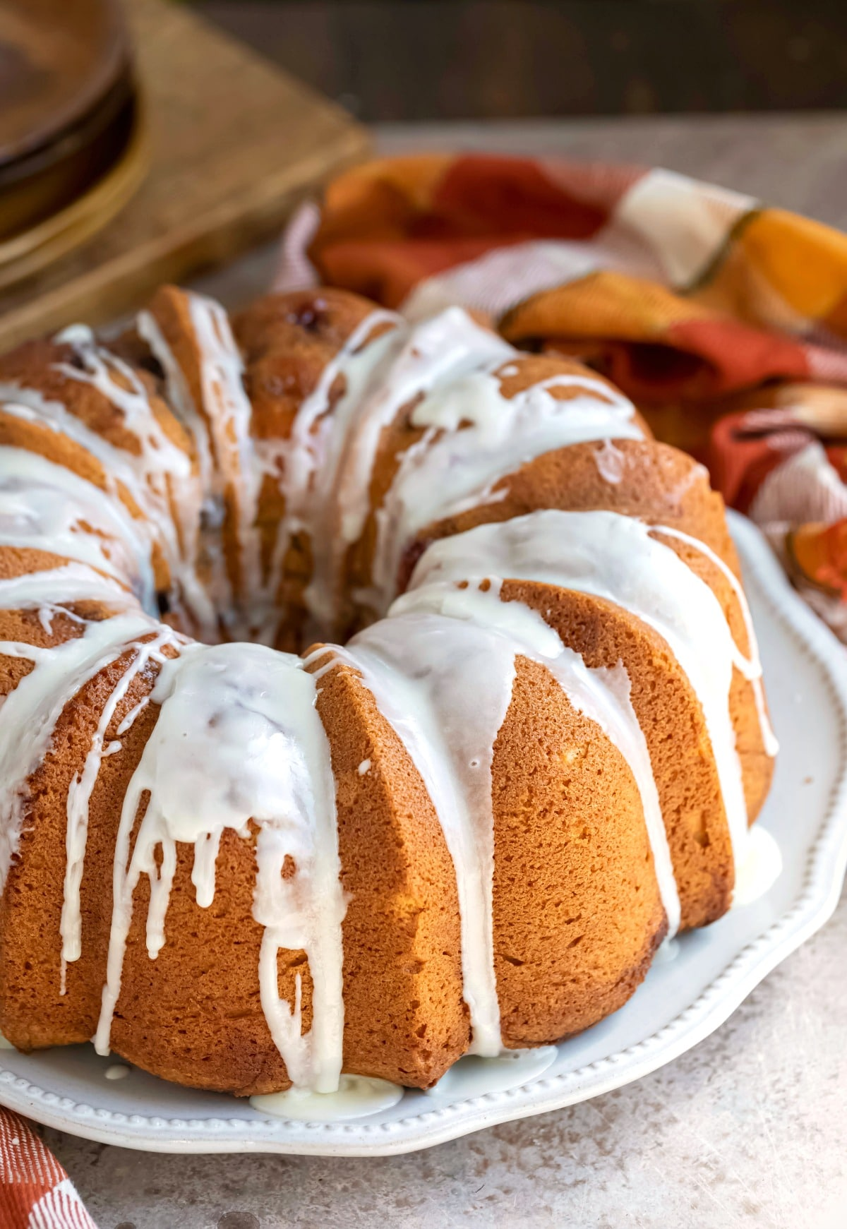 Glazed cranberry orange pound cake on a white platter