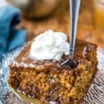 Piece of sticky toffee pudding cake topped with whipped cream