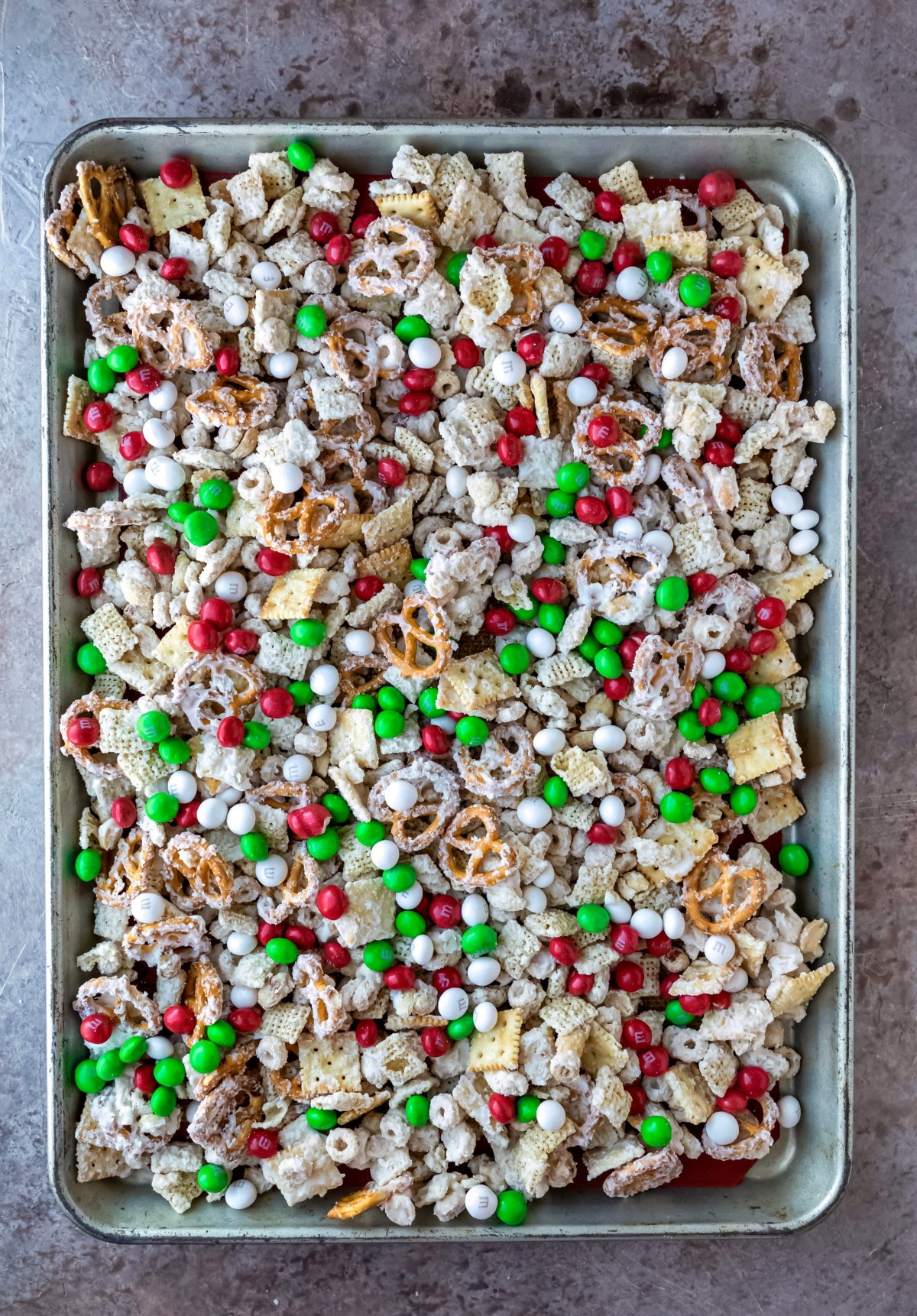 White chocolate party mix on a rimmed baking sheet