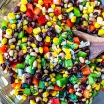 A wooden spoon scooping up cowboy caviar
