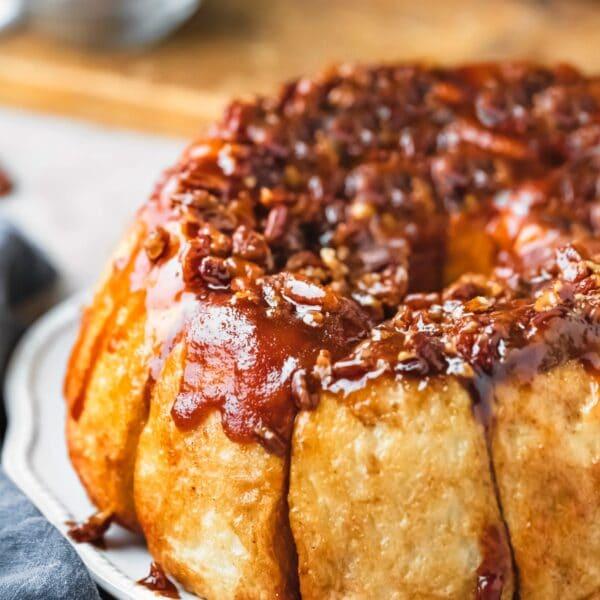Easy overnight sticky buns on a white scalloped platter