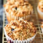 granola muffins on a gold wire cooling rack
