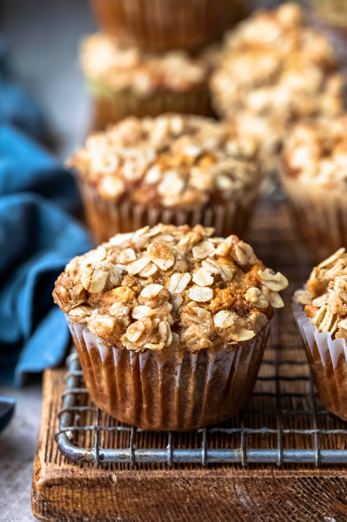 Row of banana oatmeal muffins next to a blue linen napkin