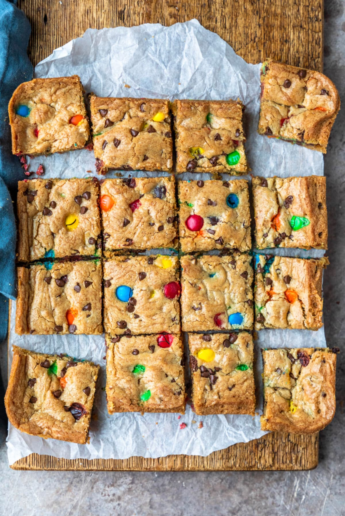 M&M cookie bars on a piece of parchment paper