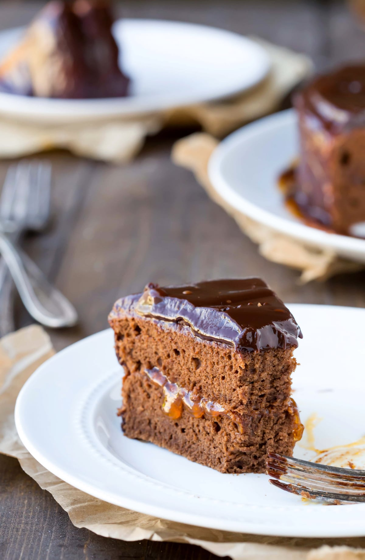 slice of Sacher Torte on a plate with a bite missing