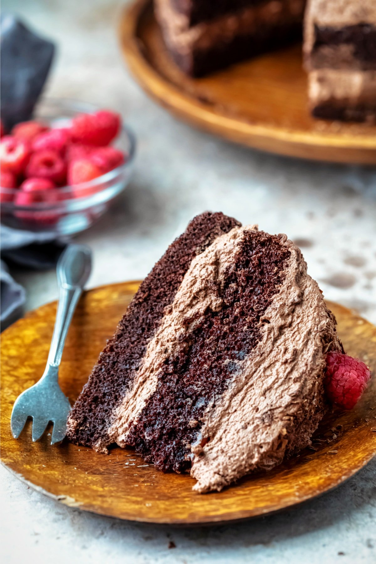 Slice of chocolate brownie cake on a wooden plate