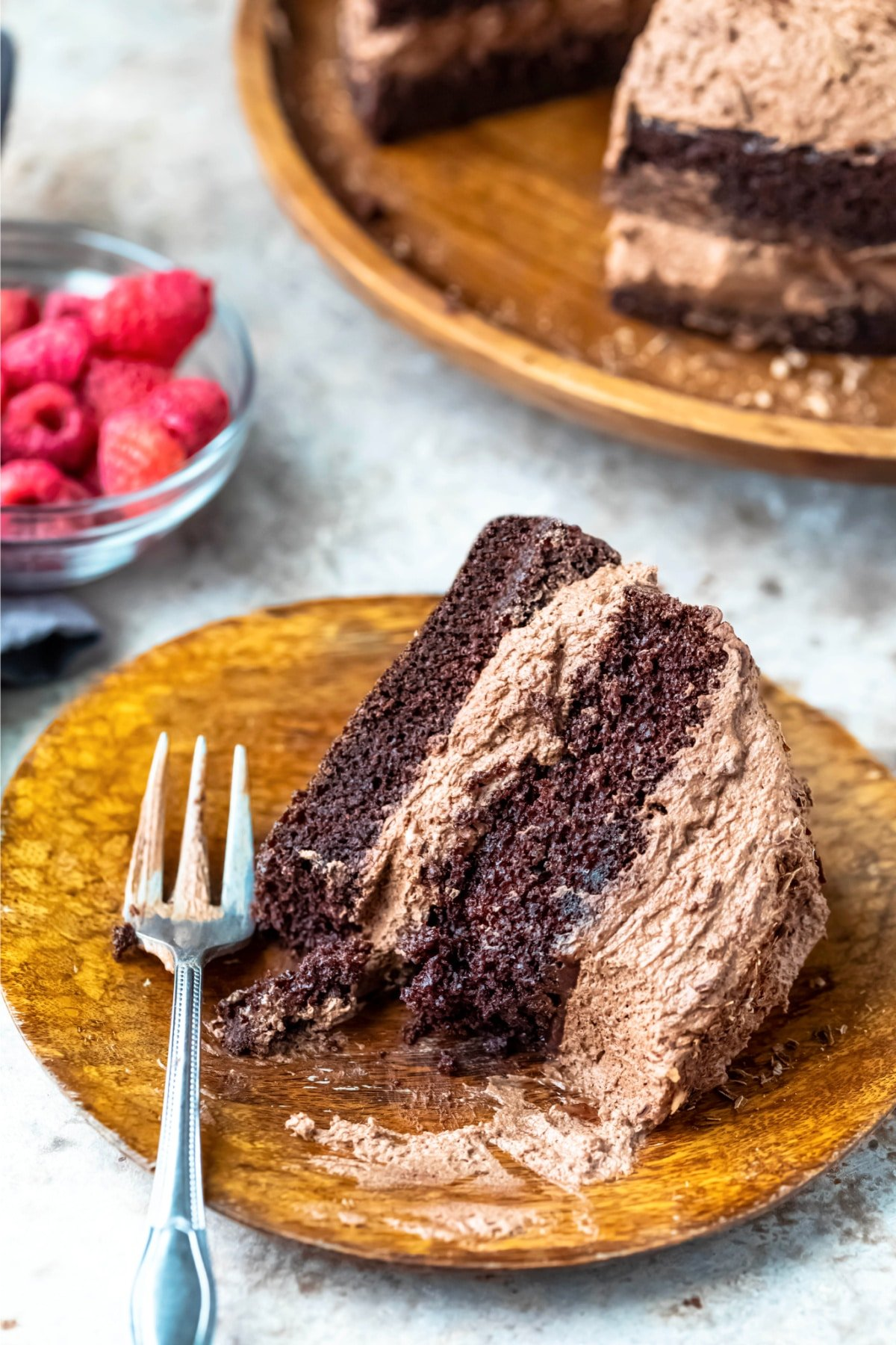 Slice of chocolate brownie cake with a bite missing