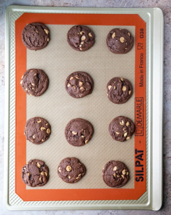 baked chocolate peanut butter cookies on a cookie sheet