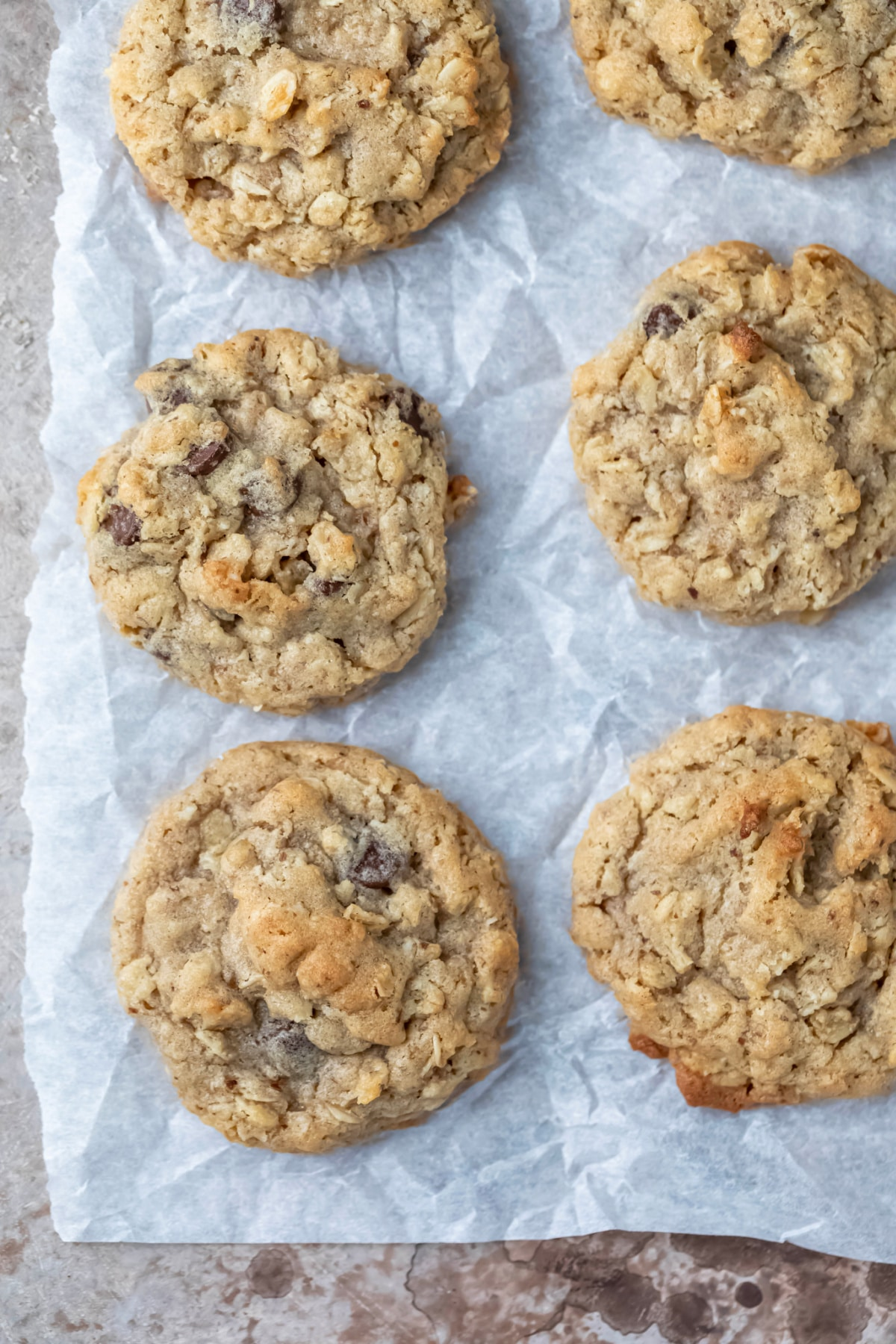 six lactation cookies on a piece of parchment paper