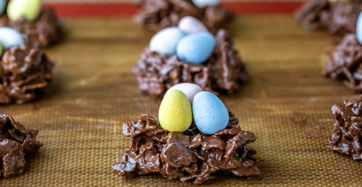 chocolate bird's nest cookies on a silicone baking mat.