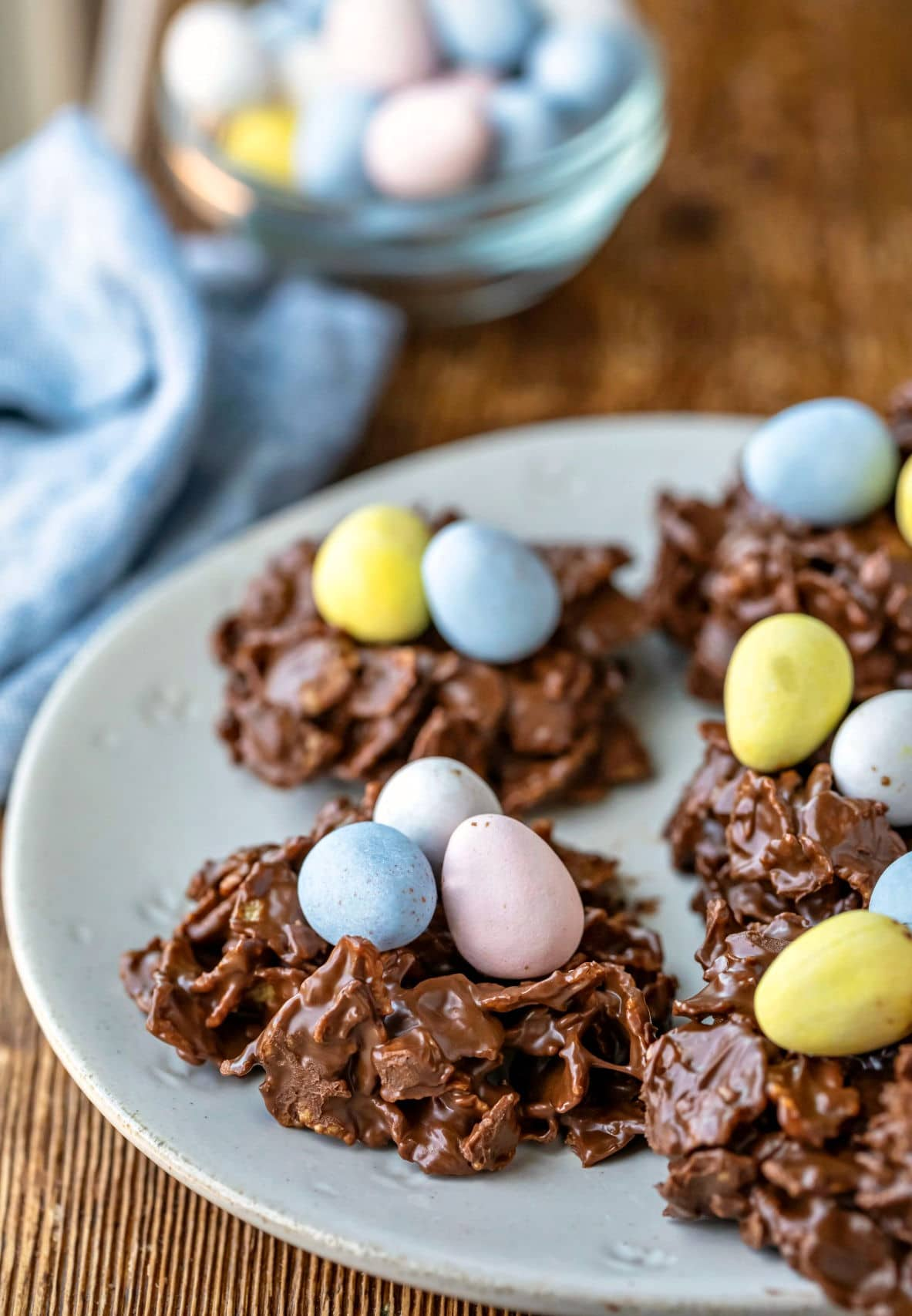 Plate of bird's nest cookies topped with mini eggs.