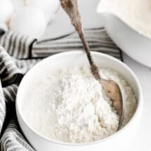 Silver spoon in a bowl of cake flour.