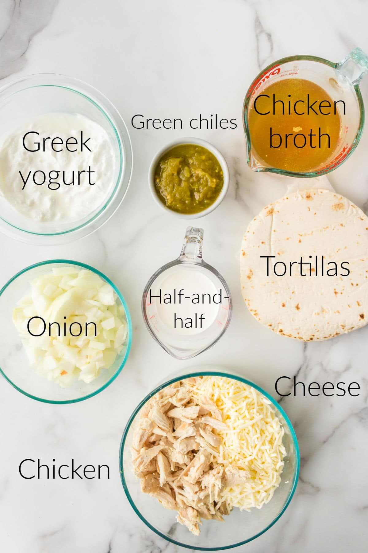 White chicken enchilada ingredients in bowls with labels on the photo.