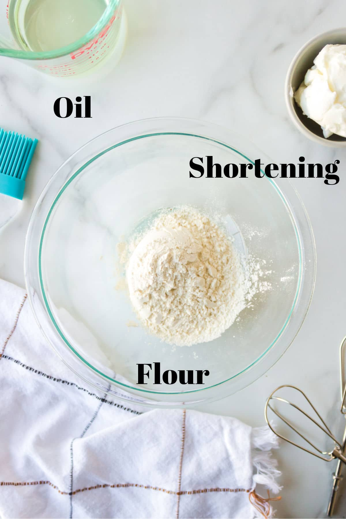 Photo of oil shortening and flour in dishes with labels.