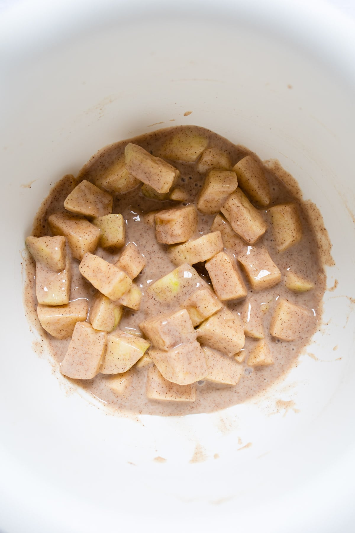 sour cream apple pie filling in a mixing bowl.