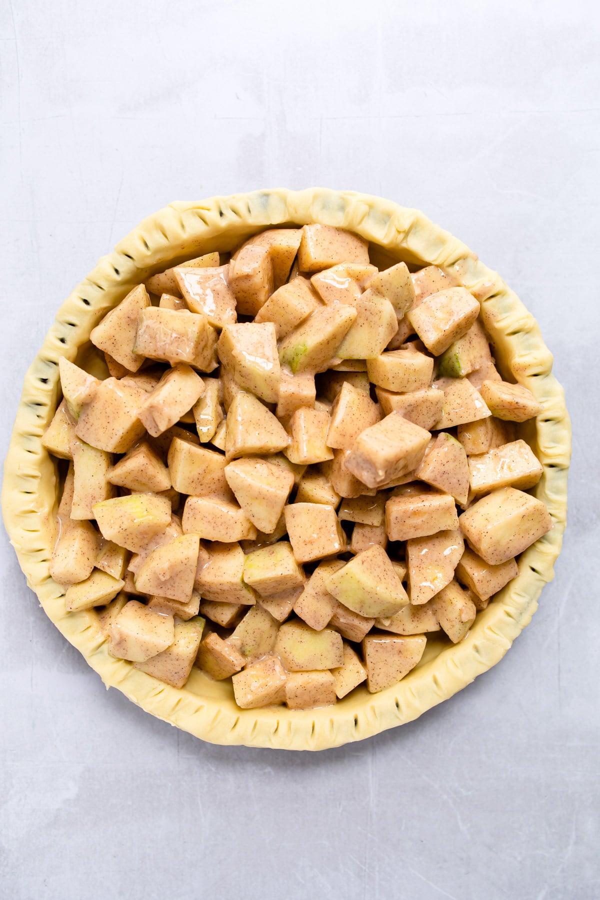 apple pie filling in an unbaked pie crust.
