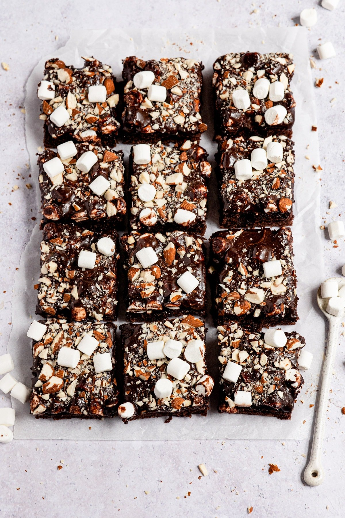 Rocky road sheet cake cut into slices.