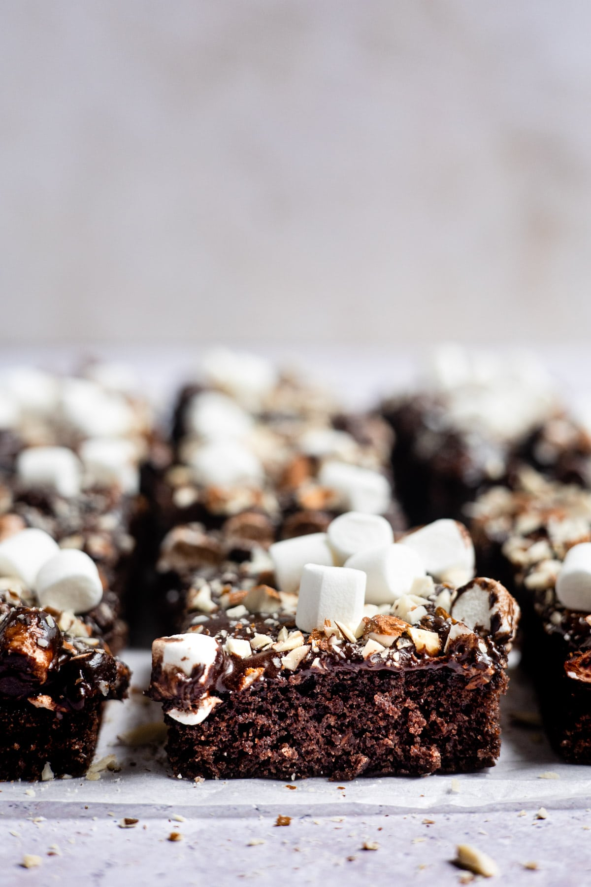 Side view of slices of rocky road sheet cake in rows.