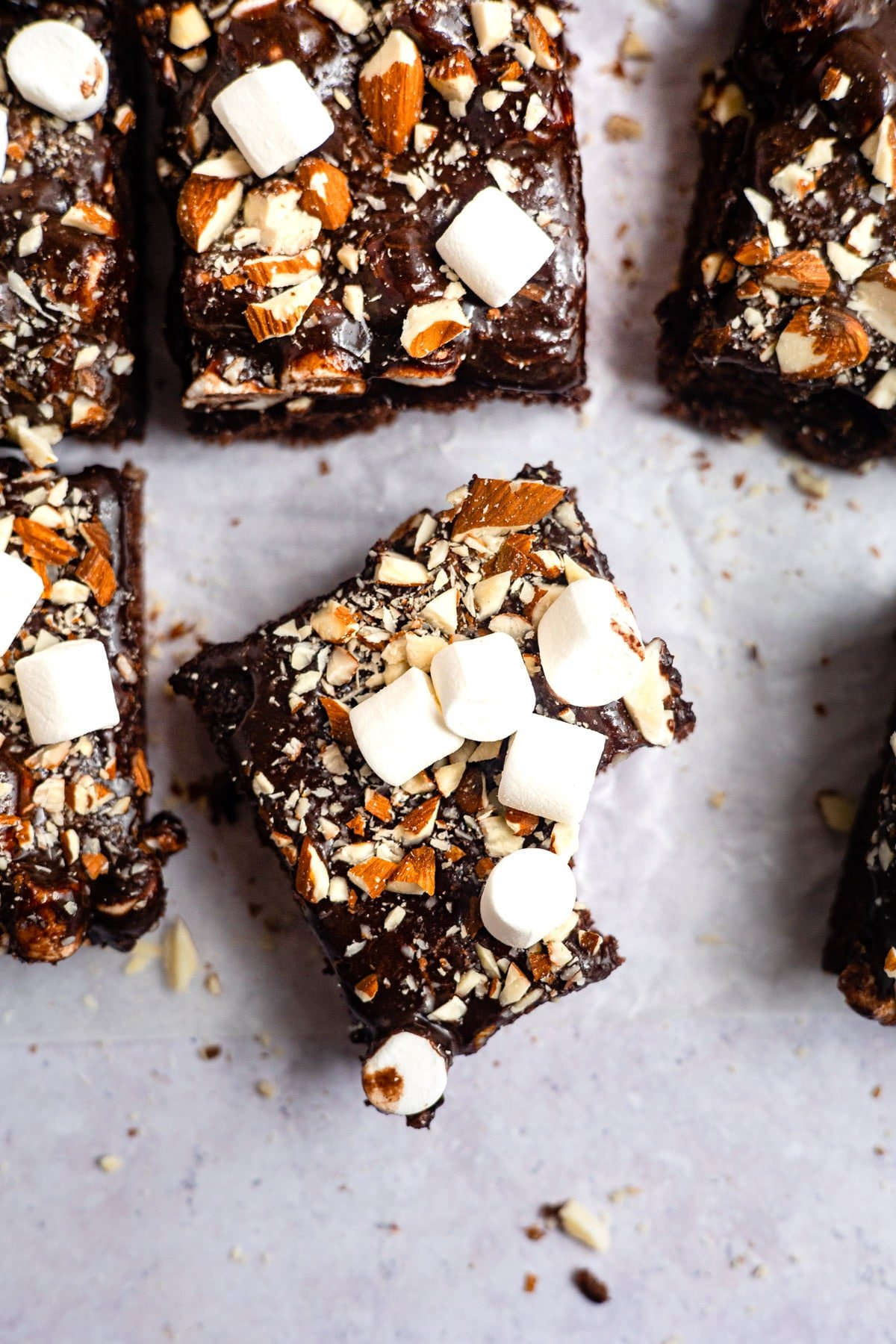Slice of rocky road sheet cake with a bite out of it.