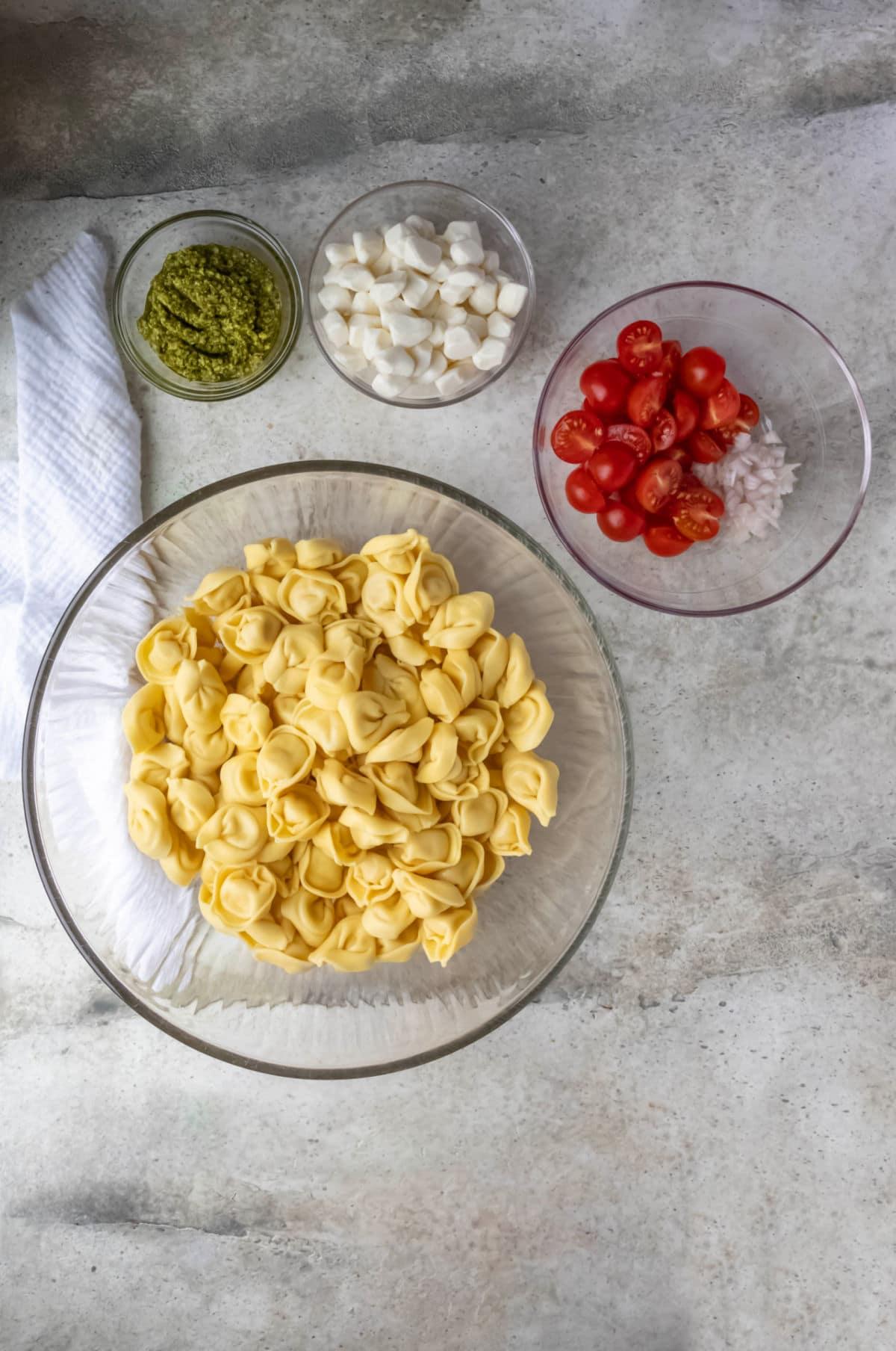 Fresh tortellini in a glass mixing bowl.