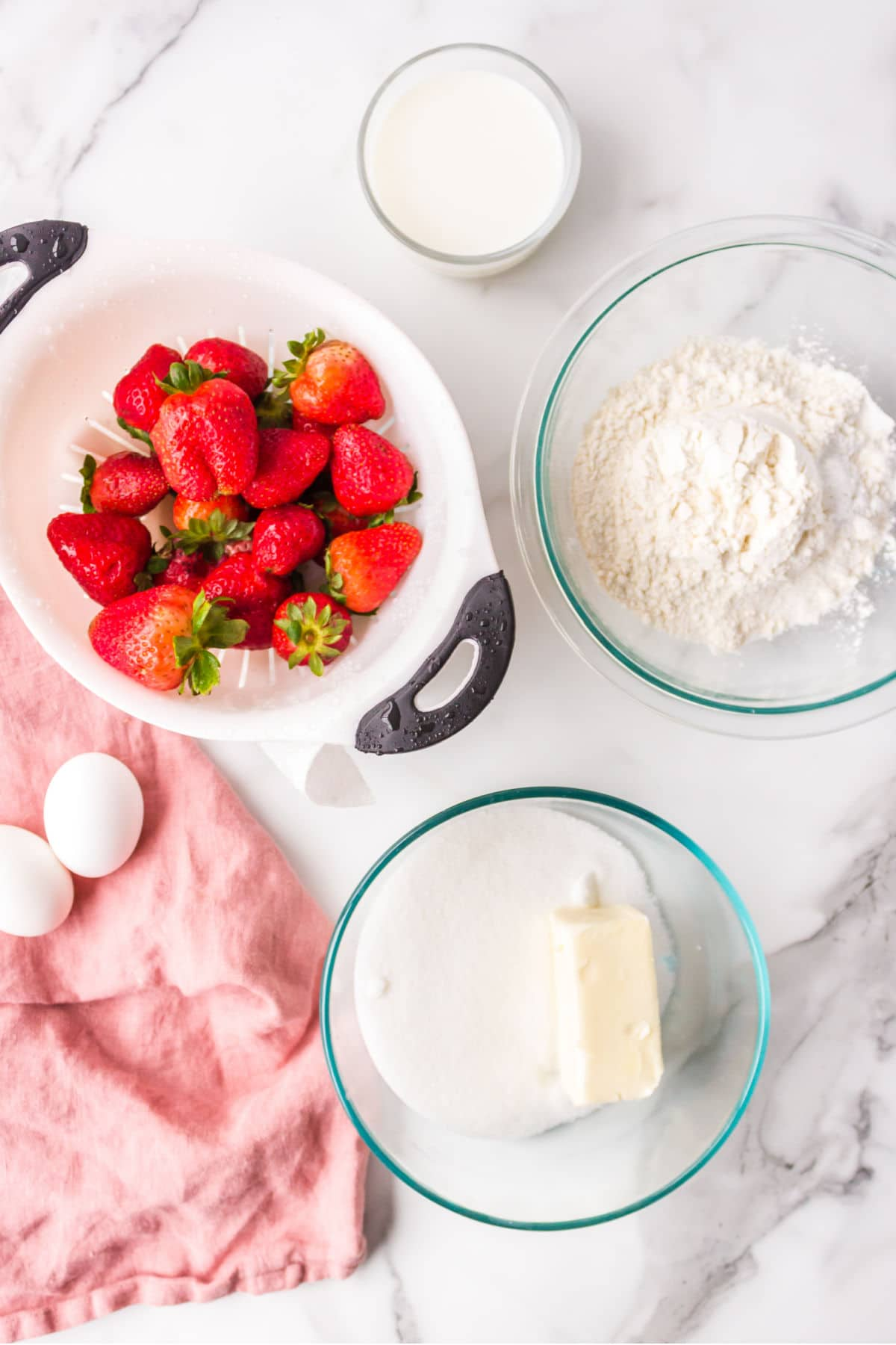 Ingredients for strawberry shortcake bars in bowls.