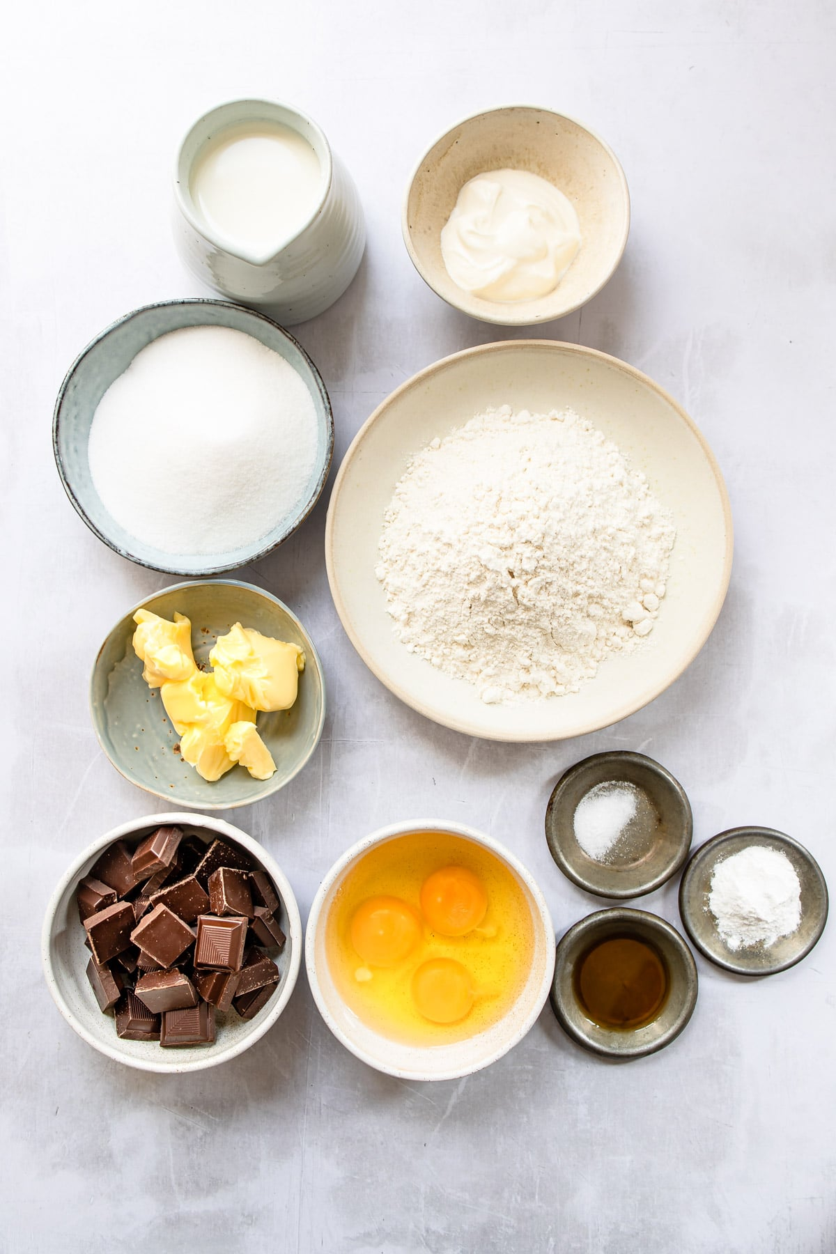 Ingredients for Boston cream pie cupcakes in dishes.