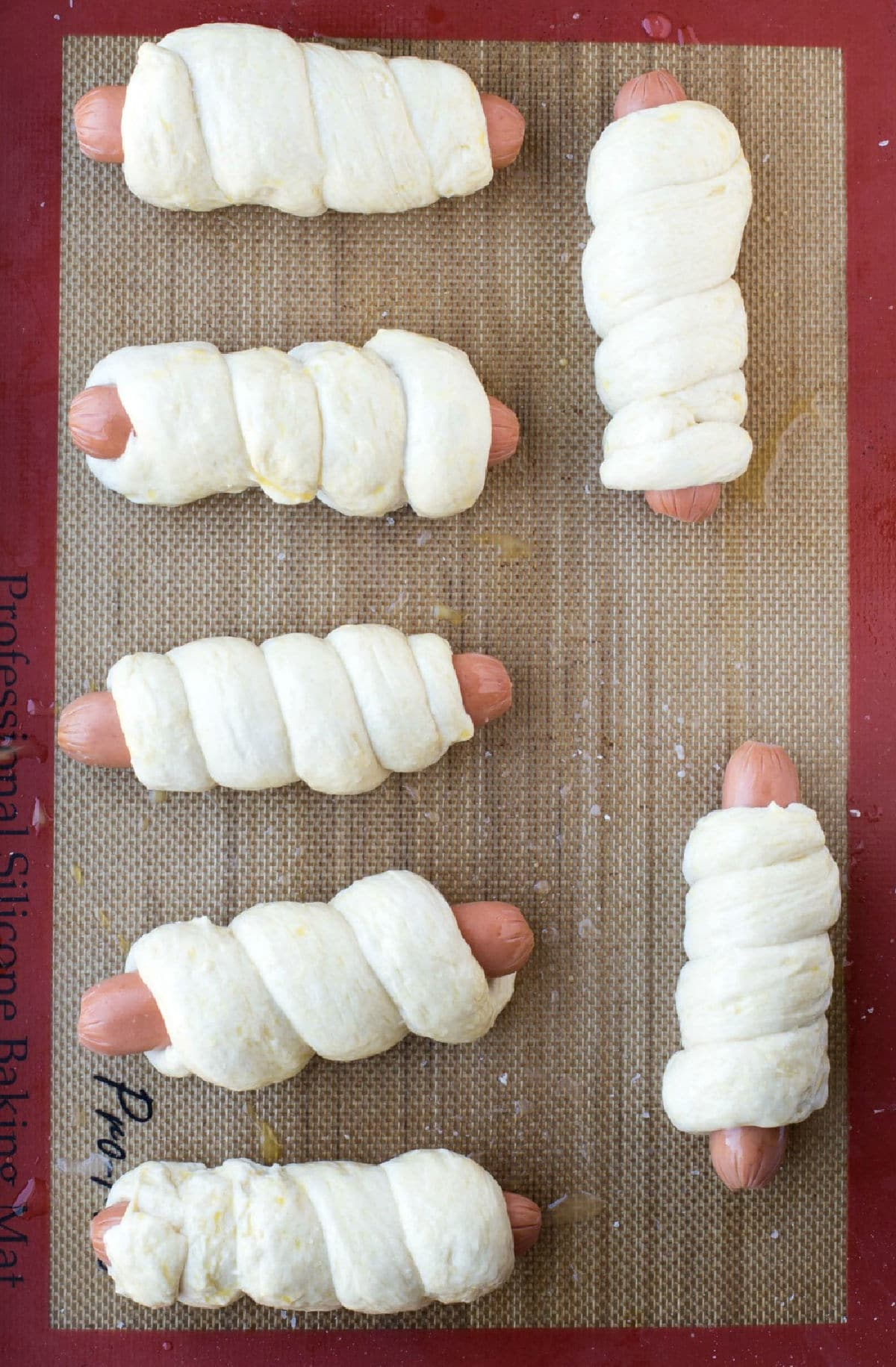 Unbaked pretzel dough wrapped around hot dogs.