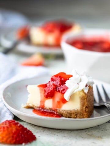 Homemade strawberry topping on a slice of cheesecake.