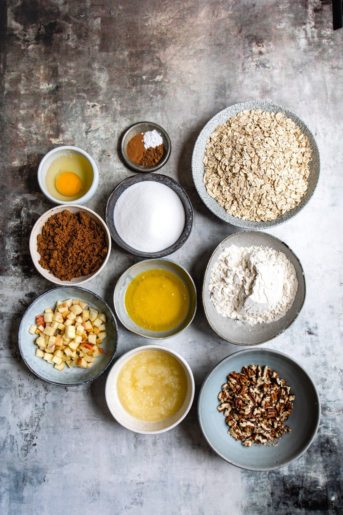 Ingredients for apple crisp cookies in dishes.